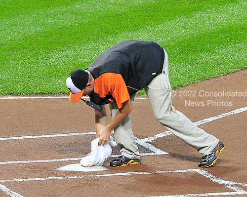 An unidentified Baltimore Orioles groundskeeper dries home plate prior to the game against the New York Yankees at Oriole Park at Camden Yards in Baltimore, Maryland on Saturday, September 8, 2012. .Credit: Ron Sachs / CNP.(RESTRICTION: NO New York or New Jersey Newspapers or newspapers within a 75 mile radius of New York City)