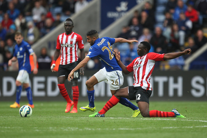 Leicester City's Riyad Mahrez (C) and Southampton's Victor Wanyama (R) in action during todays match  <br /> <br /> Photographer Jack Phillips/CameraSport<br /> <br /> Football - Barclays Premiership - Leicester City v Southampton - Saturday 9th May 2015 - King Power stadium - Leicester<br /> <br /> &copy; CameraSport - 43 Linden Ave. Countesthorpe. Leicester. England. LE8 5PG - Tel: +44 (0) 116 277 4147 - admin@camerasport.com - www.camerasport.com