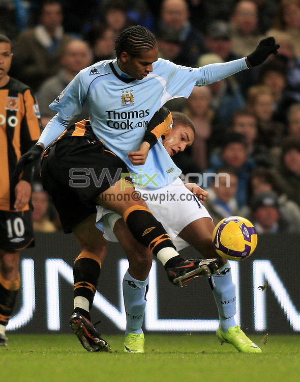 Pix: Chris Mangnall/SWpix.com, Football   Barclays Premier League. 26/12/08 Manchester City v Hull City....picture copyright>>Simon Wilkinson>>07811267 706>>....Man City's Jo and Hull's Nathan Doyle chalenge for the Ball