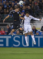 March 3rd, 2013: Ramiro Corrales and Tony Beltran jumps for the ball during a game at Buck Shaw Stadium, Santa Clara, Ca.  Salt Lake Real defeated San Jose Earthquakes