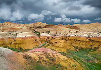 Badlands National Park, South Dakota:  <br /> Clearing storm clouds over the eroded Yellow Mounds landforms near Dillon pass