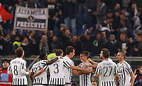 Calcio, Serie A: Lazio vs Juventus. Roma, stadio Olimpico, 4 dicembre 2015.<br /> Juventus' Paulo Dybala, fourth from right, celebrates with teammates after scoring during the Italian Serie A football match between Lazio and Juventus at Rome's Olympic stadium, 4 December 2015.<br /> UPDATE IMAGES PRESS/Riccardo De Luca
