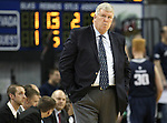 Utah State's Head Coach Stew Morrill works the sidelines during an NCAA college basketball game against Nevada, in Reno, Nev., on Tuesday, Jan. 20, 2015. Utah State won 70-54. (AP Photo/Cathleen Allison)
