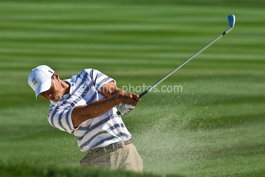 Feb 26, 2009; Marana, AZ, USA; Tiger Woods (USA) hits out of a fairway bunker on the 11th hole during the second round of the World Golf Championships-Accenture Match Play Championship at the Ritz-Carlton Golf Club, Dove Mountain.  Tim Clark (RSA), not pictured, defeated Woods 4 and 2.