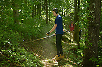 NWA Democrat-Gazette/BEN GOFF @NWABENGOFF<br /> Demetrius Mulkey, volunteering with a group from Rush Running, uses a string trimmer along a section of trail Sunday, May 21, 2017, during a volunteer trail work day organized by Ozark Off Road Cyclists at Hobbs State Park - Conservation Area near Rogers. About 50 volunteers from running and biking groups cleared vegetation and repaired storm damage to get the trails in top condition before the June 3 War Eagle Trail Running Festival and June 11 Battle for Townsend's Ridge mountain bike race.