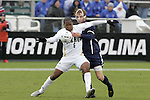 13 December 2009: Akron's Darlington Nagbe (6) and Virginia's Greg Monaco (behind). The University of Akron Zips played the University of Virginia Cavaliers at WakeMed Soccer Stadium in Cary, North Carolina in the NCAA Division I Men's College Cup Championship game.