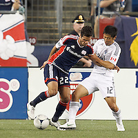 New England Revolution forward Benny Feilhaber (22) dribbles as Vancouver Whitecaps FC defender Young-Pyo Lee (12) defends. In a Major League Soccer (MLS) match, the New England Revolution defeated Vancouver Whitecaps FC, 4-1, at Gillette Stadium on May 12, 2012.