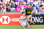#12 Alex Davis of England (L) tries to tackle #1 Heino Bezuidenhout of South Africa (R) during the HSBC Hong Kong Sevens 2018 match between South Africa and England on April 7, 2018 in Hong Kong, Hong Kong. Photo by Marcio Rodrigo Machado / Power Sport Images