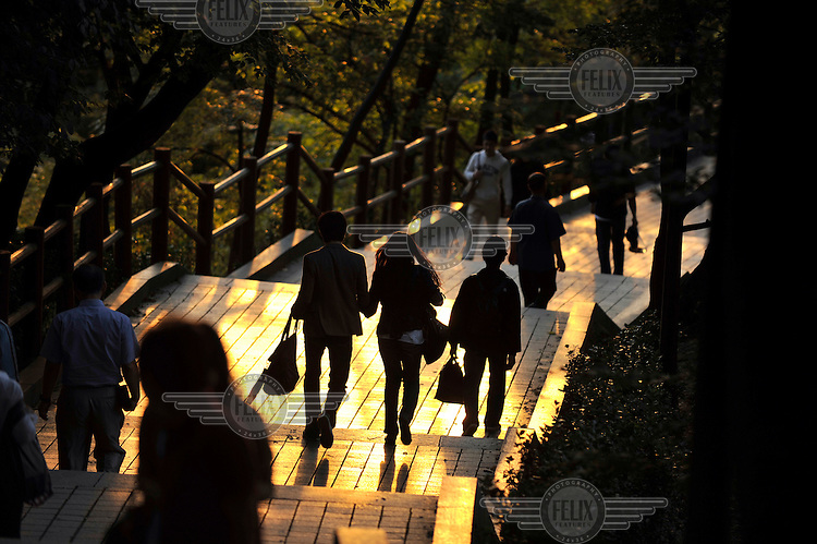 People walking through the park, which surrounds Seoul Tower.