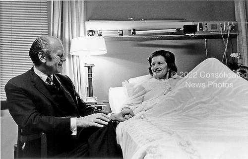 United States President holds hands with his wife, first lady Betty Ford while visiting her at the Bethesda National Naval Medical Center in Bethesda, Maryland on October 3, 1974.  Mrs. Ford is in the hospital recovering from cancer surgery.<br /> Mandatory Credit: David Hume Kennerly / White House via CNP