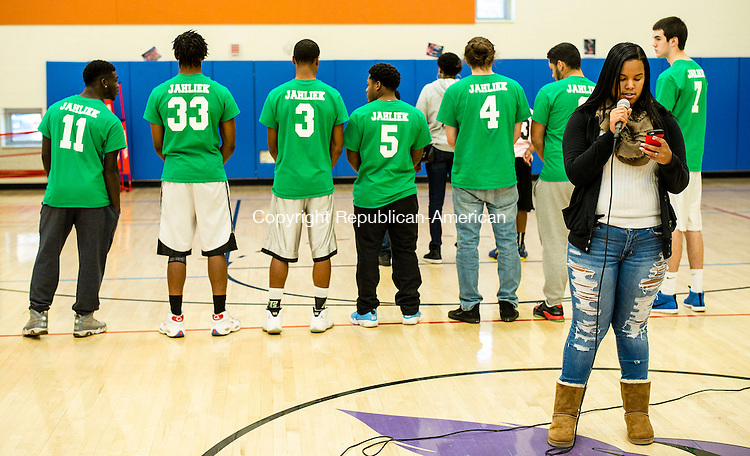 """WATERBURY, CT- 13 November 2016-111316CM10- Jenai Frenette reads a poem during a basketball tournament in Waterbury on Sunday.  Standing behind her are members of """"Team Jahliek"""",  named after Jahliek Diudonne, who was killed on  November 5, 2016.  Christopher Massa Republican-American"""