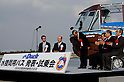 "November 14, 2011 : Tokyo, Japan - Guests are posing for pictures during the press conference of ""Tokyo's First Amphibian Bus Sky Duck"" at the Wakasu Kaihin park in Tokyo. Hinomaru Limousine Inc. announced Tokyo's new way of sightseeing Sky Duck bus tour. Tokyo is one of the greatest tourism places in the world, and they would like to emphasis Tokyo as a city of waterways for the next step. In addition, this bus would be used as a delivery car when any national disaster happens. (Photo by Yumeto Yamazaki/AFLO)"