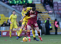 Fleetwood Town's Ched Evans battles with Bradford City's Jacob Butterfield<br /> <br /> Photographer David Shipman/CameraSport<br /> <br /> The EFL Sky Bet League One - Bradford City v Fleetwood Town - Saturday 9th February 2019 - Valley Parade - Bradford<br /> <br /> World Copyright &copy; 2019 CameraSport. All rights reserved. 43 Linden Ave. Countesthorpe. Leicester. England. LE8 5PG - Tel: +44 (0) 116 277 4147 - admin@camerasport.com - www.camerasport.com