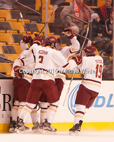 The Eagles celebrate Casey Fitzgerald's (BC - 5) goal. - The Boston College Eagles defeated the Harvard University Crimson 3-2 in the opening round of the Beanpot on Monday, February 1, 2016, at TD Garden in Boston, Massachusetts.