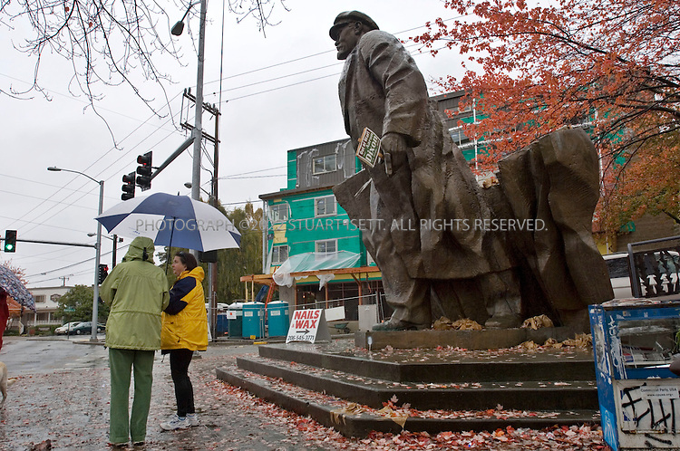 11/07/2006--Seattle, WA, USA..A statue of Vladimir Lenin stands in Seattle's Fremont neighborhood. The neighborhood is home to the controversial statue of Lenin salvaged from Slovakia by a local art lover who was teaching in the area at the time. After the 1989 fall of the communist government, he brought the statue to Fremont with money raised through a mortgage on his house..Photograph By Stuart Isett.All photographs ©2006 Stuart Isett.All rights reserved.