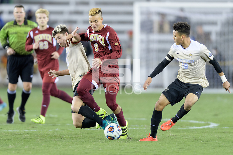 Houston, TX - Friday December 9, 2016: Andre Shinyashik (9) of the Denver Pioneers battles for the ball with Ian Harkes (16) and Alex Knox (18) of the Wake Forest Demon Deacons at the  NCAA Men's Soccer Semifinals at BBVA Compass Stadium.