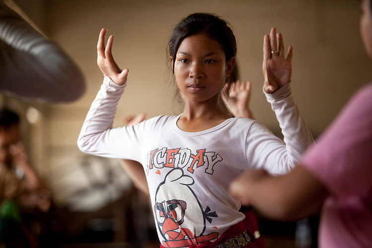 Young dancers practice traditional Cambodian dance which they perform at the National Museum in Phnom Penh, Cambodia. <br /> <br /> Photos &copy; Dennis Drenner 2013.