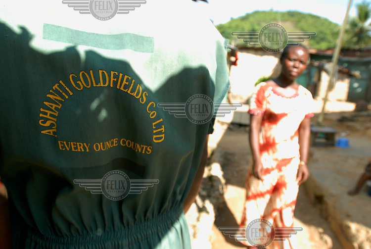 A worker from the AngloGold Ashanti gold mine wears overalls emblazoned with the company's logo. ...