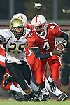 Lawndale, CA 10/01/10 - Kaelyn Henderson (C)  (Lawndale #4) and Logan Okuda (Peninsula #25) in action during the Peninsula-Lawndale Varsity football game.