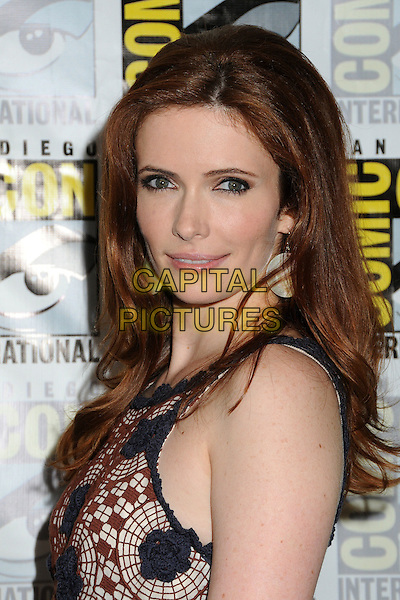 "Bitsie Tulloch .""Grimm"" Press Room at Comic-Con 2012 held at the Bayfront Hilton Hotel, San Diego, California, USA..July 14th, 2012.headshot portrait blue beige print brown side .CAP/ADM/BP.©Byron Purvis/AdMedia/Capital Pictures."