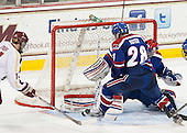 Brooks Dyroff (BC - 14), Jake Suter (UML - 28), Connor Hellebuyck (UML - 37) - The University of Massachusetts Lowell River Hawks defeated the Boston College Eagles 4-2 (EN) on Tuesday, February 26, 2013, at Kelley Rink in Conte Forum in Chestnut Hill, Massachusetts.