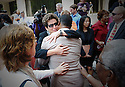 Lance Madison, whose brother Ronald Madison was killed by police officers during the aftermath of Hurricane Katrina, hugs Barbara 'Bobbi' Bernstein, lead prosecutor for the U.S. Justice Department, after the jury delivered guilty verdicts for all five officers charged with the crimes, Friday, Aug. 5, 2011. The officers were found not guilty of the murder charges.