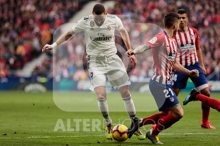 Atletico de Madrid's Lucas Hernandez and Real Madrid's Karim Benzema during La Liga match between Atletico de Madrid and Real Madrid at Wanda Metropolitano Stadium in Madrid, Spain. February 09, 2019. (ALTERPHOTOS/A. Perez Meca)