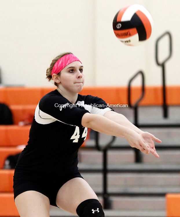 Terryville, CT- 03 October 2013-100313CM06-  NEWS ACTION MAN, FIRST--- Terryville's Lucy Munger sets to the hit the ball during a volleyball matchup against Naugatuck Thursday night in Terryville.  Christopher Massa Republican-American