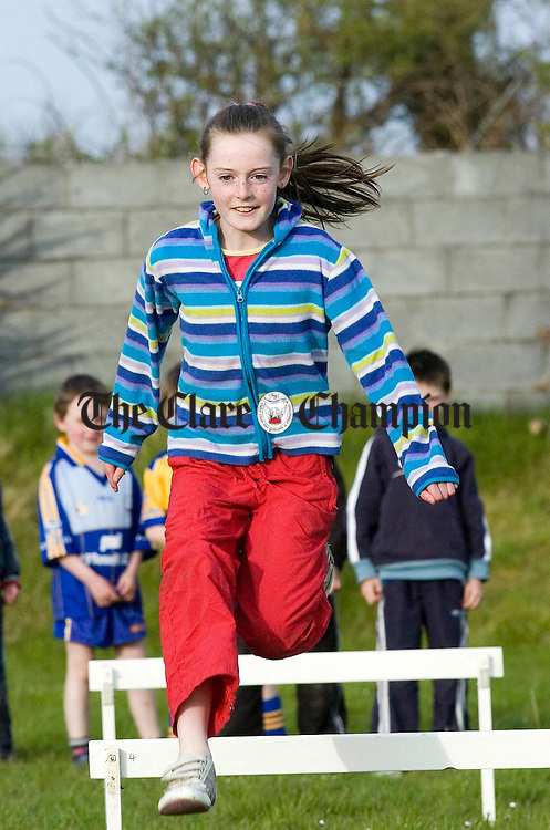 10 year old Rachel Clancy jumps the hurdles during games for kids at O'Currys GAA Pitch in Doonaha.Pic Arthur Ellis