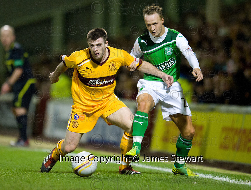 MOTHERWELL'S STEVEN JENNINGS STEALS THE BALL OFF HIBERNIAN'S LEIGH GRIFFITHS