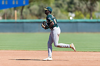 Oakland Athletics right fielder Lawrence Butler (14) jogs off the field between innings of an Instructional League game against the Los Angeles Dodgers at Camelback Ranch on September 27, 2018 in Glendale, Arizona. (Zachary Lucy/Four Seam Images)
