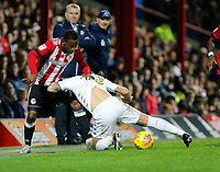 Florian Jozefzoon of Brentford and Gaetano Berardi of Leeds United during the Sky Bet Championship match between Brentford and Leeds United at Griffin Park, London, England on 4 November 2017. Photo by Carlton Myrie.