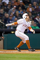 Mark Payton #2 of the Texas Longhorns follows through on his swing against the Rice Owls at Minute Maid Park on February 28, 2014 in Houston, Texas.  The Longhorns defeated the Owls 2-0.  (Brian Westerholt/Four Seam Images)