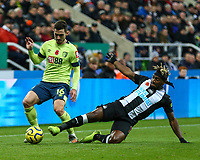 9th November 2019; St James Park, Newcastle, Tyne and Wear, England; English Premier League Football, Newcastle United versus AFC Bournemouth; Lewis Cook of AFC Bournemouth is tackled by Jetro Willems of Newcastle United - Strictly Editorial Use Only. No use with unauthorized audio, video, data, fixture lists, club/league logos or 'live' services. Online in-match use limited to 120 images, no video emulation. No use in betting, games or single club/league/player publications