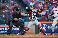 Arkansas Razorbacks catcher Casey Opitz (12) makes a throw to second base against the Oklahoma Sooners in game two of the 2020 Shriners Hospitals for Children College Classic at Minute Maid Park on February 28, 2020 in Houston, Texas. The Sooners defeated the Razorbacks 6-3. (Brian Westerholt/Four Seam Images)