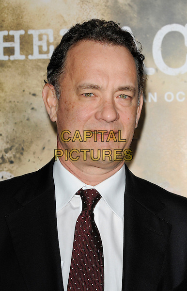 "TOM HANKS.at the Los Angeles premiere of HBO's new miniseries event ""The Pacific"" at Grauman's Chinese Theatre in Hollywood, California, USA..February 24th, 2010..portrait headshot red maroon tie black white shirt polka dot .CAP/ROT.©Lee Roth/Capital Pictures"