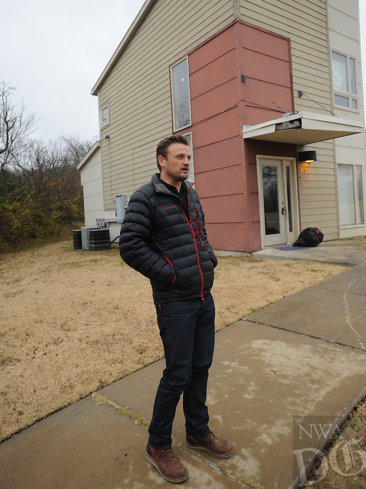 NWA Democrat-Gazette/ANDY SHUPE<br /> Solomon Burchfield, director of operations for Seven Hills, speaks Wednesday, Dec. 7, 2016, in front of one of the buildings at the Walker Family Residential Community that is operated by the organization. The city of Fayetteville has pledged $103,000 towards operational costs and maintenance.