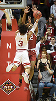 NWA Democrat-Gazette/CHARLIE KAIJO Arkansas Razorbacks forward Gabe Osabuohien (22) blocks a shot from Indiana Hoosiers forward Justin Smith (3) during the first half of the NCAA National Invitation Tournament, Saturday, March 23, 2019 at the Simon Skjodt Assembly Hall at the University of Indiana in Bloomington, Ind. The Arkansas Razorbacks fell to the Indiana Hoosiers 63-60.