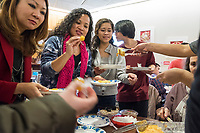 Karonika Brown, 34, (second from left) and Socheata Mam, 19, (third from left) try Lunar New Year treats from various Asian countries at a Lunar New Year celebration at Middlesex Community College's Asian American Connections Center on Thurs., Feb. 15, 2018. The Asian American Connections Center was established at the school using a federal grant in 2016 and serves as a focal point for the Asian community at the school, predominantly Cambodian, to gather, socialize, study, and otherwise take part in student life.