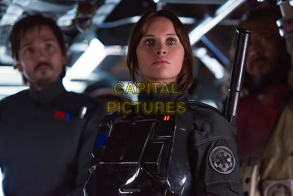 Rogue One: A Star Wars Story (2016)<br />  Cassian Andor (Diego Luna), Jyn Erso (Felicity Jones), and Baze Malbus (Jiang Wen).<br /> *Filmstill - Editorial Use Only*<br /> CAP/KFS<br /> Image supplied by Capital Pictures