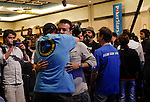Alexandre Gomes gets a hug from a supporter after winning a big pot.