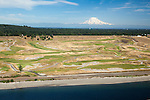 aerial view of the Chambers Bay Golf Course, anchored by the Lone Fir standing watch behind the 15th green, with Mount Rainier rising in the distance, site of the 2015 US Open Championship; University Place, WA near Tacoma