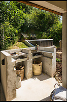 BNPS.co.uk (01202 558833)<br /> Pic: UniqueHomeStays/BNPS<br /> <br /> Concrete BBQ.<br /> <br /> Bomb proof hideaway - the perfect place to cement a relationship...<br /> <br /> A concrete carport has been transformed into a ultra cool luxury staycation bolt hole - with even its fireplace, kitchen worktops and bath made from concrete. <br /> <br /> The Hide is perfect for romantic weekends away or creative solo escapes but it will set the minimalist traveller back up to &pound;2,350 a week in peak season.<br /> <br /> Despite its slightly industrial appearance, it is actually a cosy rural retreat, surrounded by nature at the end of a winding country lane three miles from Perranporth beach in north Cornwall.<br /> <br /> Unique Home Stays used a bird hide as the inspiration with quirky stick-out windows that allow guests to stargaze from the bed and lighting designed to replicate the effect of sunlight through trees.