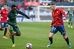 Inaki Williams of Athletic Club competes for the ball with Carlos Clerc of Club Atletico Osasuna during the match of  La Liga between Club Atletico Osasuna and Athletic Club Bilbao at El Sadar Stadium  in Pamplona, Spain. April 01, 2017. (ALTERPHOTOS / Rodrigo Jimenez)