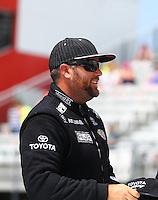 Jun 21, 2015; Bristol, TN, USA; NHRA top fuel driver Shawn Langdon during the Thunder Valley Nationals at Bristol Dragway. Mandatory Credit: Mark J. Rebilas-