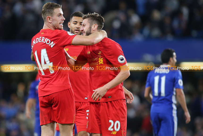 Jordan Henderson, scorer of Liverpool's second goal, celebrates at the final whistle with Adam Lallana during Chelsea vs Liverpool, Premier League Football at Stamford Bridge on 16th September 2016