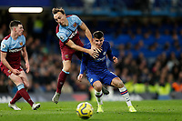 30th November 2019; Stamford Bridge, London, England; English Premier League Football, Chelsea versus West Ham United; Mark Noble of West Ham United challenges Mason Mount of Chelsea - Strictly Editorial Use Only. No use with unauthorized audio, video, data, fixture lists, club/league logos or 'live' services. Online in-match use limited to 120 images, no video emulation. No use in betting, games or single club/league/player publications