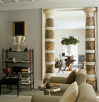 A pairt of marble columns were extended to fit the doorway of the sitting room by adding white marble inserts