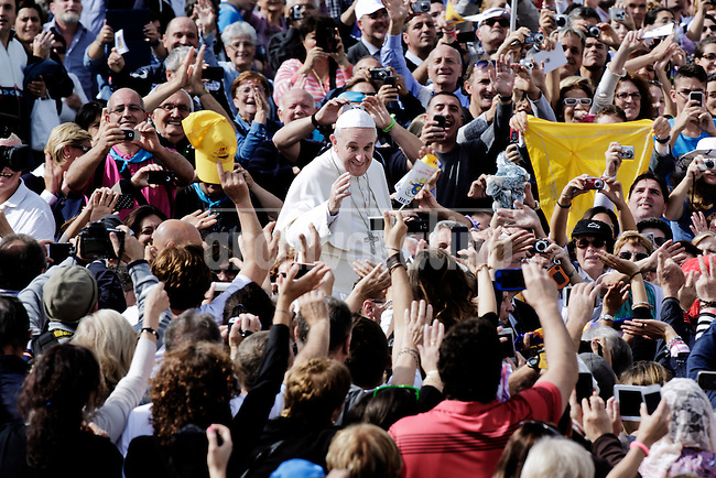 Pope Francis greets pilgrims after celebrating  the mass as part of the Marian Day event at St Peter Square in Vatican on October 13 2013