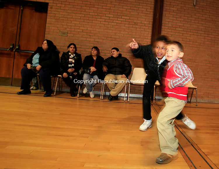 Waterbury, CT-17, December 2009-121709CM11 --   Leslie Sepulveda, 11 of Waterbury shows her brother, Dylan Sepulveda, 3 of Naugatuck, the arrival of Santa Thursday night at the Connecticut Junior Republic in Waterbury, CT.  The Christmas event was put on by Arlanda Brantley, of Brantley Bail Bonds.  Brantley donated toys and the holiday dinner for chidden who have parents incarcerated, and  for families from the Salvation Army and community who would otherwise need toys for the holidays.  Brantley was inspired by her mother, who was a Christian pastor, and wanted to carry on her legacy by giving back to the community as much as possible.      Christopher Massa Republican-American